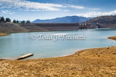 Drought claims much of Shasta Lake, as seen in summer, 2014. Here the lake is about 150 feet below the top of the spillway gates, which are open at this time.